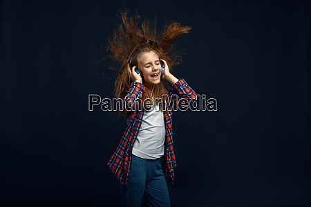 little girl in headphones developing hair