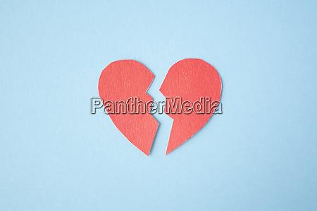 red paper broken heart on bright