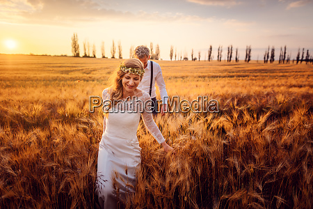 bride leading her groom to the