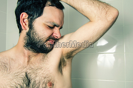 funny man having bad smell from