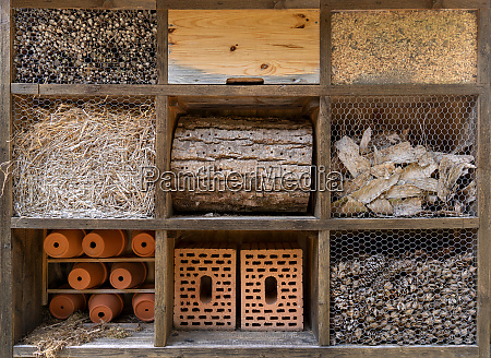 large insect hotel with nine different
