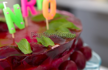birthday cake with cherries closeup