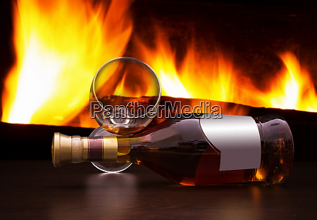 bottle of brandy with the fireplace