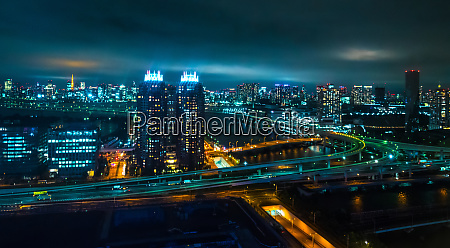aerial view over tokyo by night