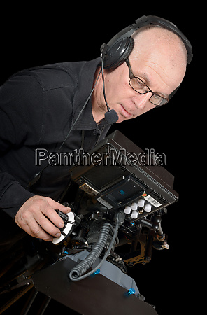 cameraman standing with a camera on