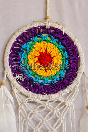 beautiful multicolored handmade dreamcatcher on white