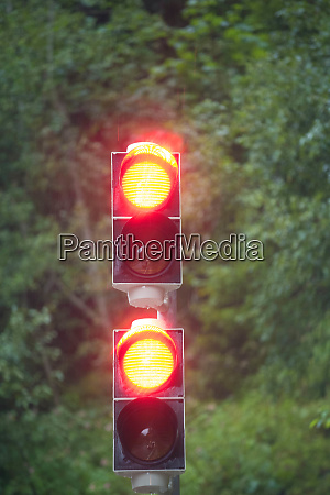 two red traffic lights with green