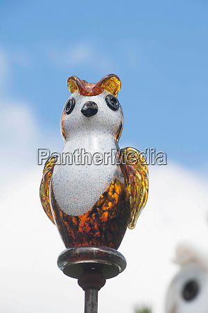glass owl figure on a stick