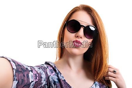 beautiful girl taking a selfie while