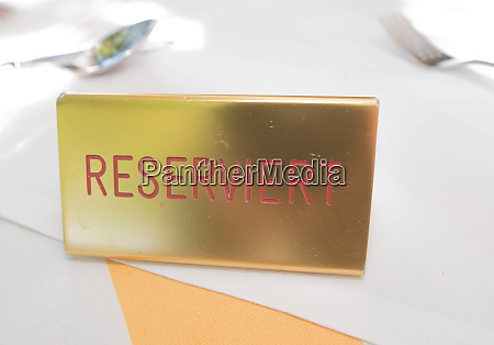 reserviert reservation sign on table