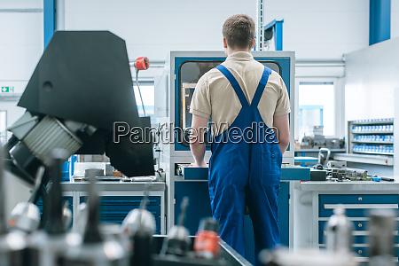 man working in factory on semi