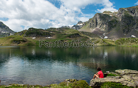 hiker woman resting by lake in