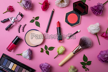 makeup products and equipment with flowers