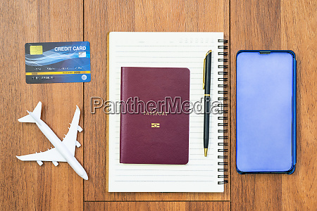 airplane by passport and cellphone with
