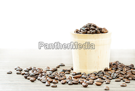 coffee beans in wood bucket on