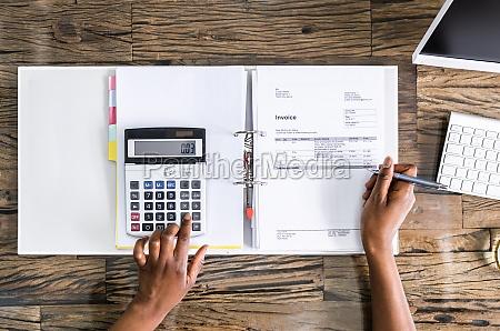 african american auditor or advisor doing