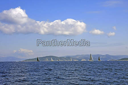 sailboats on the horizon with blue