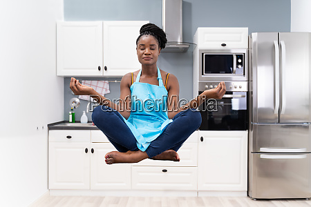 stressed african housewife woman meditating