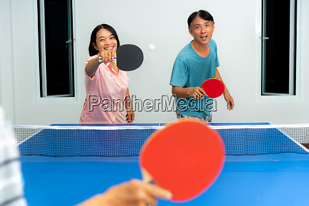 couple fun playing table tennis indoor