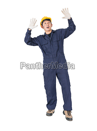 workman with blue coveralls and hardhat