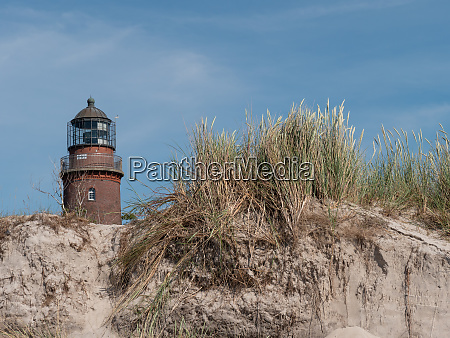 lighthouse at the beach of the