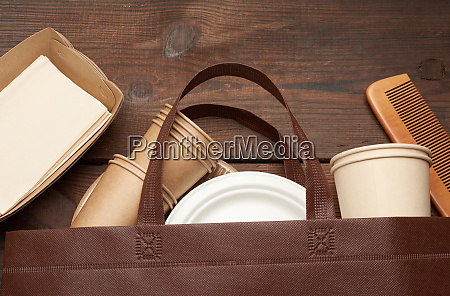 brown bag and disposable tableware from