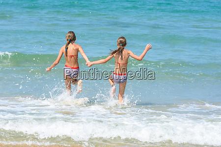 girlfriends ran into the sea view