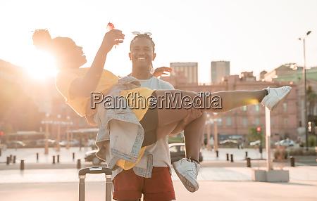 boyfriend carrying his girlfriend in a