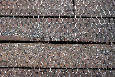 repaired wooden mesh covered boardwalk