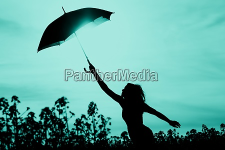 unplugged free silhouette woman has umbrella