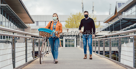 students on university campus wearing masks