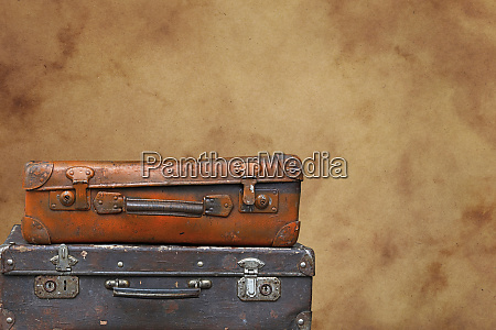 old vintage travel suitcases over brown