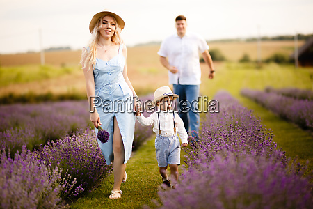a little boy walks with mom