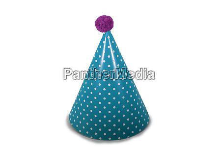 a blue birthday hat on a