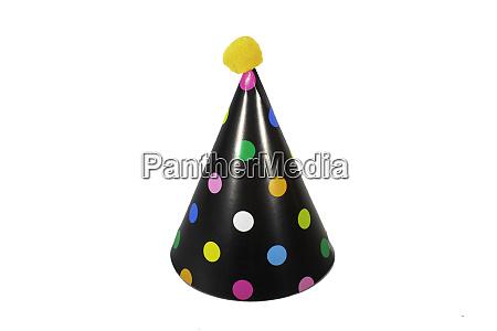 a black birthday hat on a