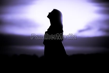 youth woman soul at purple sun
