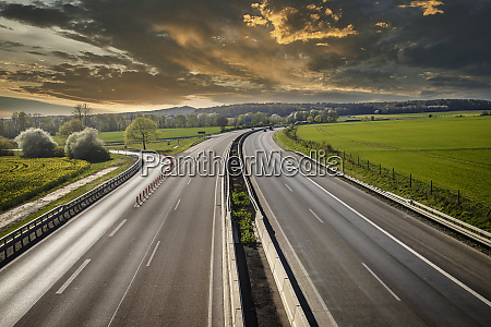 autobahn landscape with dramatic clouds