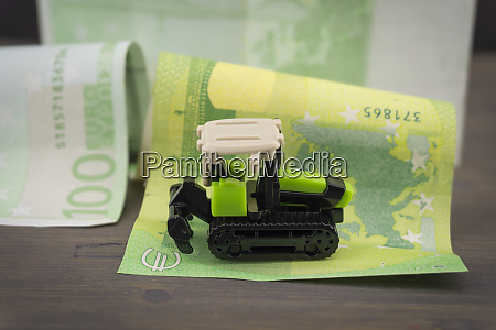 small plastic toy digger on a