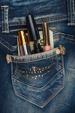 cosmetics and money sticks out of