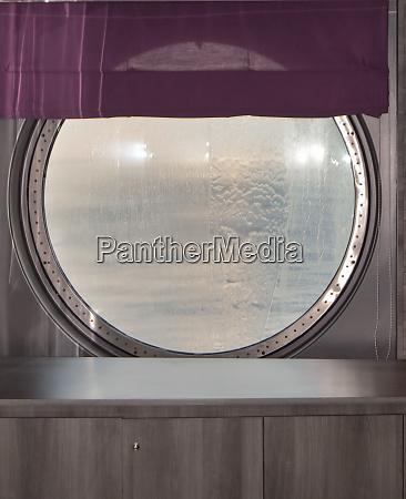 round porthole of a sea cruise