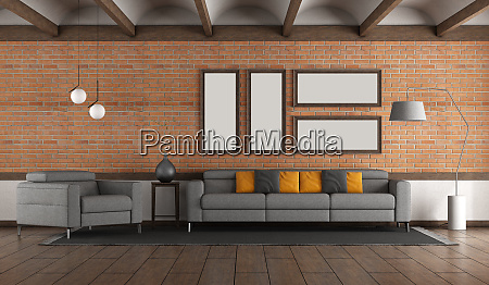 living room with brick wall and