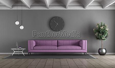living room with purple sofa