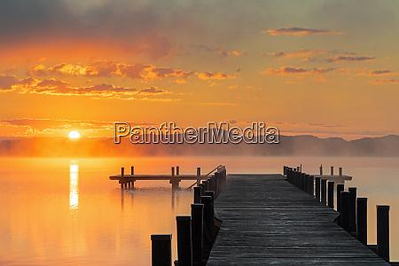 sunrise at lake woerthsee bavaria germany