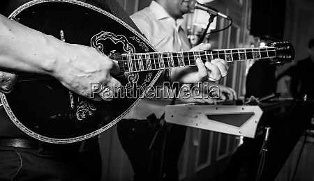 guitar player on a party greek