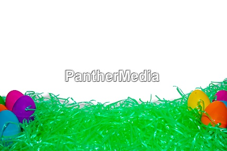 easter grass and colorful eggs with