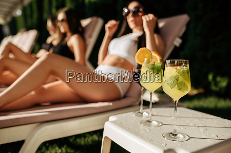 fresh coctails women leisures on background