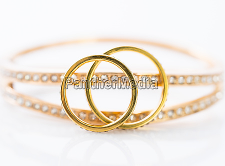 gold wedding rings on white background