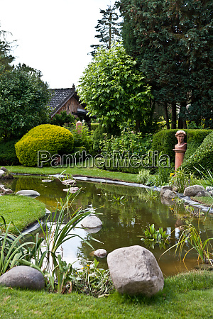 garden pond with plants and decoration
