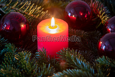christmas motif with red burning candle