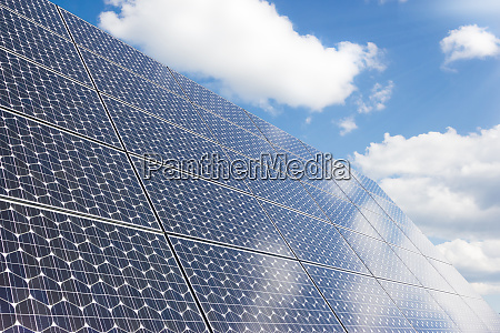 solar panel under cloudy skies